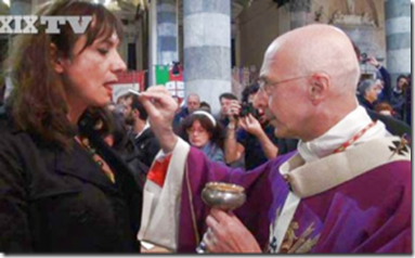Cardinal Bagnasco, president of the Italian episcopal conference, distributing Holy Communion to the trans-sexual LGBT activist Vladimir Luxuria, at the funeral of the priest advocate of homosexuality, Don Gallo.